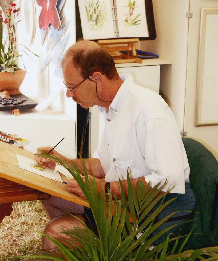 Farnham Surrey Artist Miichael Walsh painting in studio
